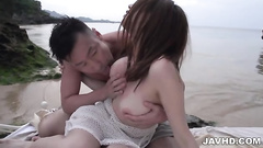 Man licking and fingering pussy on the bank