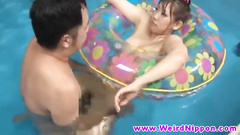 Cute Asian girl gets fucked in water of the pool