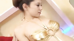 Beautiful Japanese babe is pleasantly sucking dicks in bathroom
