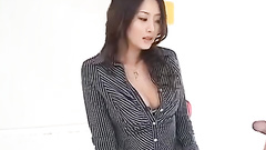 Girlie in exciting sexy office suit and short white skirt is doing hot blowjob
