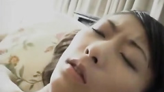 Adorable Asian teen sexily undresses and hotly masturbates cunt