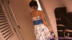 Precious young Japanese chick is showing off in sexy dress