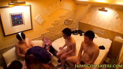 Four Japanese dudes are undressing one beauty chick