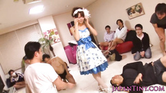 Adorable Japanese girl in beautiful dress charms hungry dudes