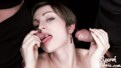 Precious brown haired European girl blowjobs two cocks